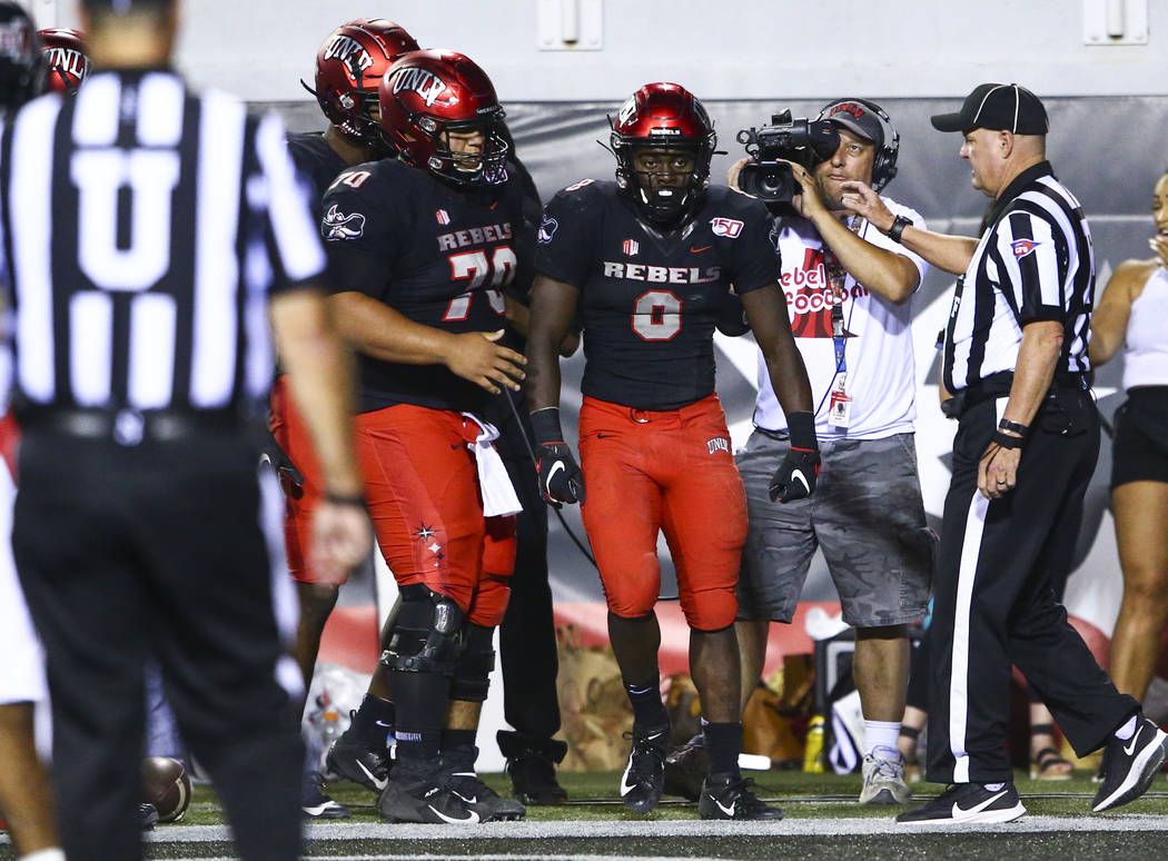 UNLV Rebels running back Charles Williams (8) after scoring a touchdown against the Arkansas St ...