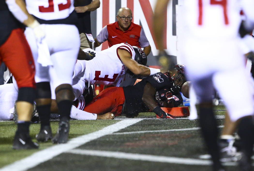 UNLV Rebels running back Charles Williams (8) scores a touchdown in front of Arkansas State Red ...