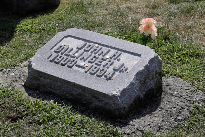 FILE - In this Aug. 1, 2019 file photo, the headstone of John Dillinger is seen at Crown Hill C ...