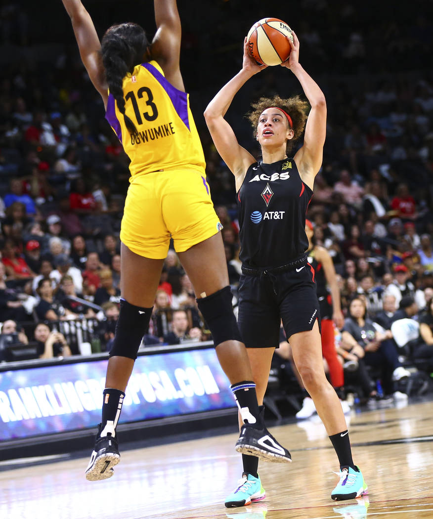 Las Vegas Aces' Dearica Hamby looks to shoot over Los Angeles Sparks' Chiney Ogwumike (13) duri ...