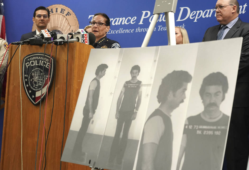 Torrance Police Chief Eve R. Irvine speaks at a press conference in front of a 1972 booking pho ...