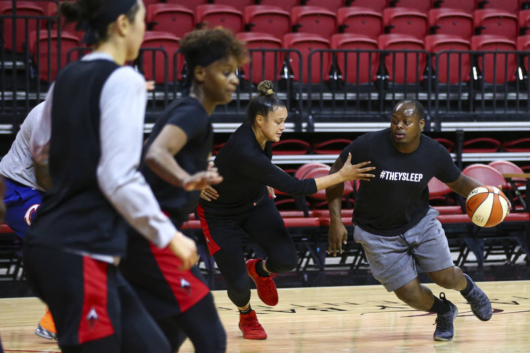 Dreu Johnson, right, drives the ball under pressure from Las Vegas Aces' Kayla McBride during p ...