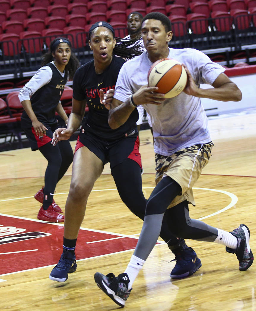 Rodney Grant, right, drives the ball under pressure from Las Vegas Aces' center A'ja Wilson dur ...