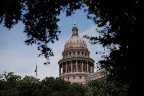 FILE - In This July 30, 2013, file photo, the dome of the Texas State Capital is seen through t ...