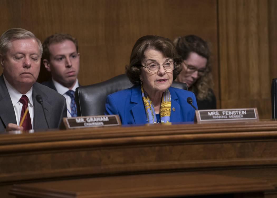 Senate Judiciary Committee Chairman Lindsey Graham, R-S.C., left, listens as Sen. Dianne Feinst ...