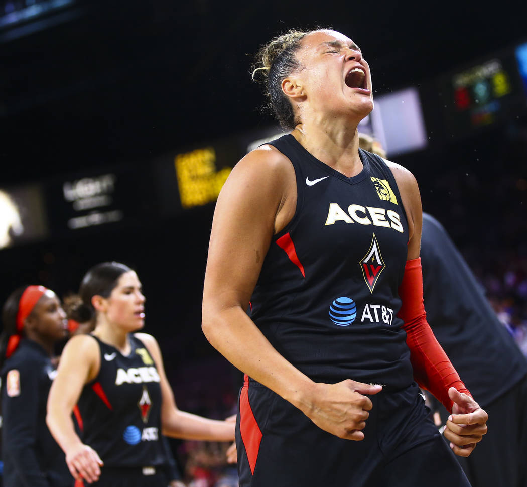Las Vegas Aces' Kayla McBride (21) reacts during the second half of a WNBA basketball game agai ...