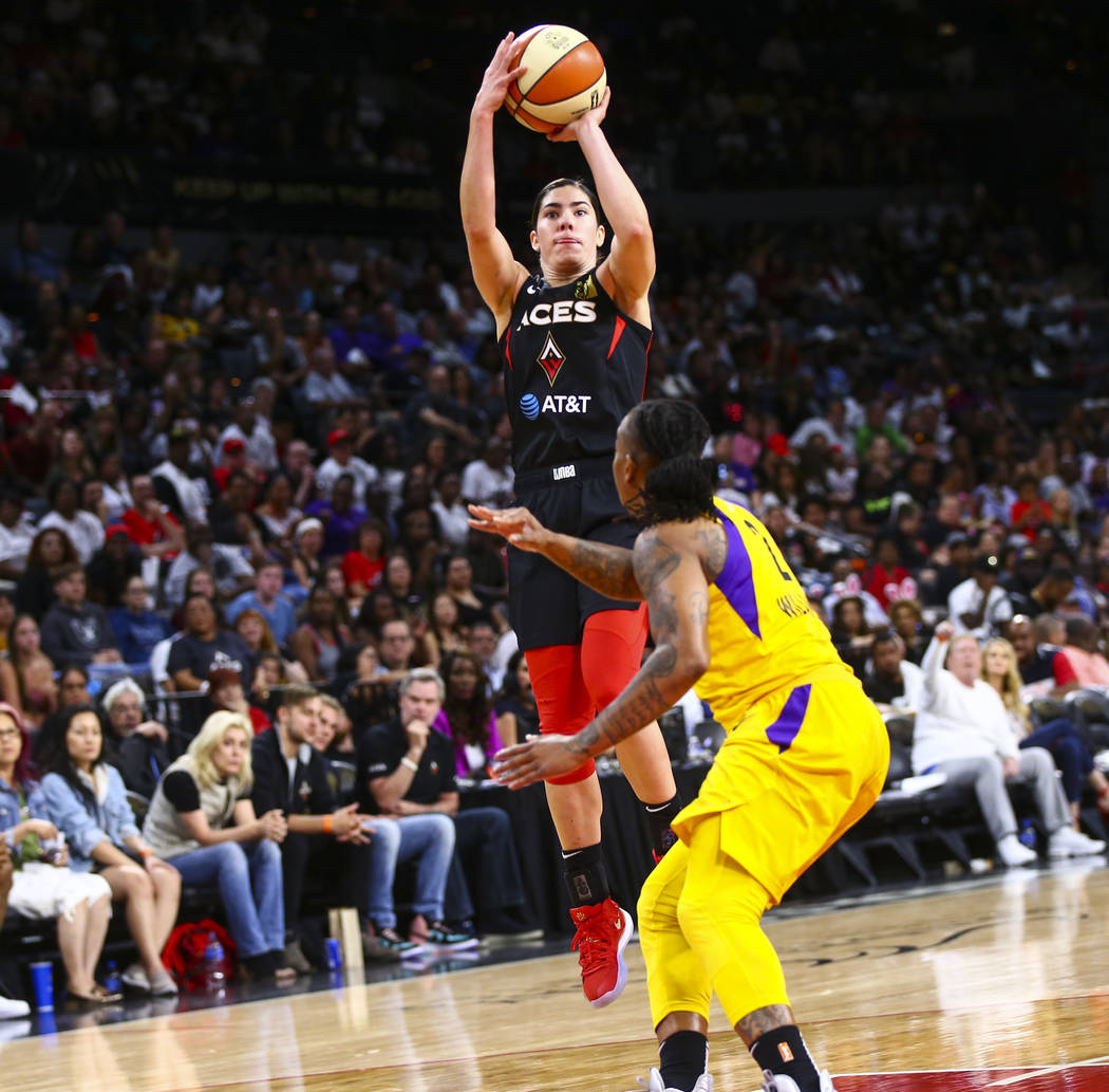 Las Vegas Aces' Kelsey Plum shoots over Los Angeles Sparks' Riquna Williams (2) during the seco ...