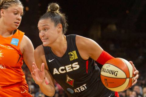 Las Vegas Aces guard Kayla McBride (21) runs to the hoop against Connecticut Sun guard Rachel B ...