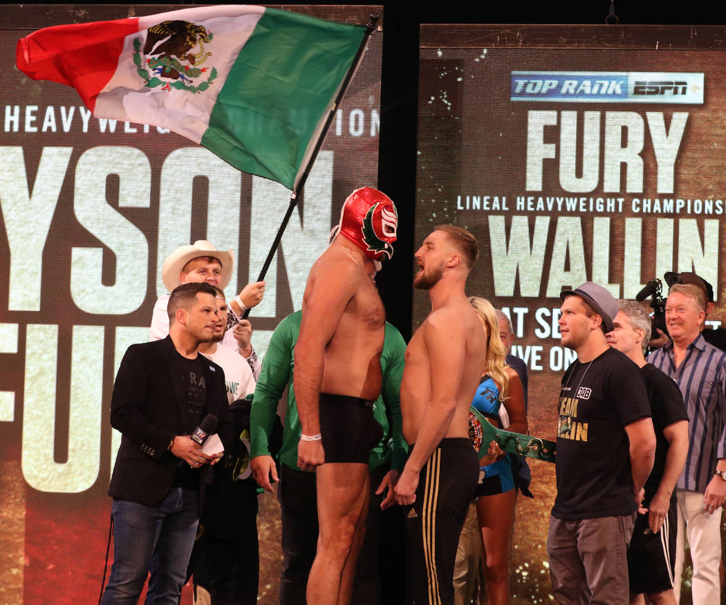 Tyson Fury, in a Mexican wrestling mask, and Otto Wallin engage in a staredown at a weigh-in on ...