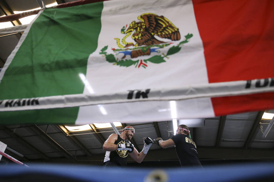 Tyson Fury, left, with her trainer Ben Davison, prepare for their upcoming heavyweight bout, at ...