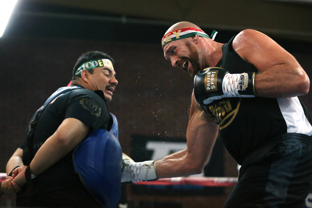 Tyson Fury, right, with his training camp assistant and outman Jorge Capetillo, prepare for the ...