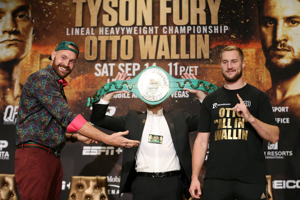 Tyson Fury, left, with Otto Wallin, pose during a press conference at the MGM Grand hotel-casin ...