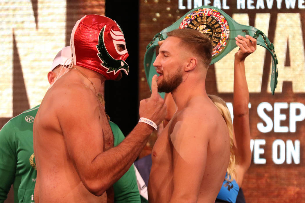 Tyson Fury, left, and Otto Wallin face-off at a weigh-in on Friday, Sept. 13, 2019 at the MGM G ...