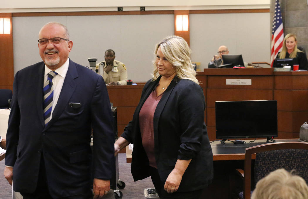 Shelly Calderon and her attorney, Dominic Gentile leave the courtroom after Calderon's initial ...
