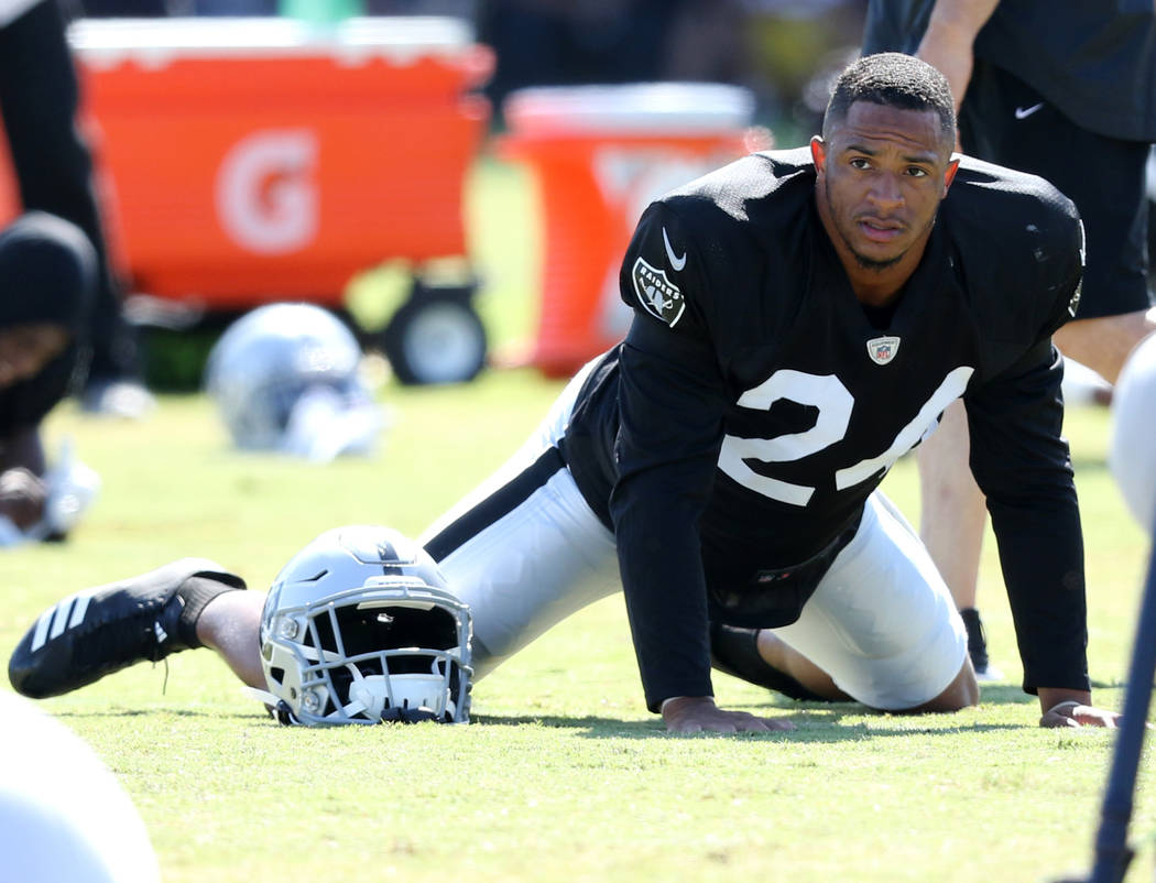 Oakland Raiders safety Johnathan Abram (24) warms up during the NFL team's joint training camp ...