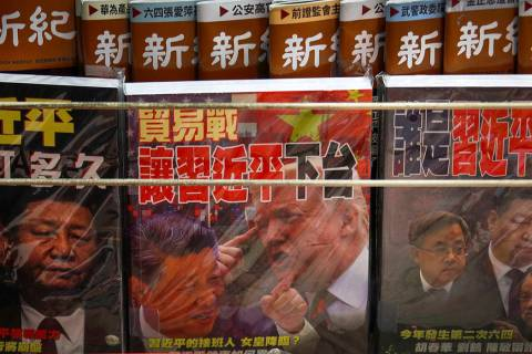 FILE - In this July 4, 2019, file photo, magazines with a front cover featuring Chinese Preside ...