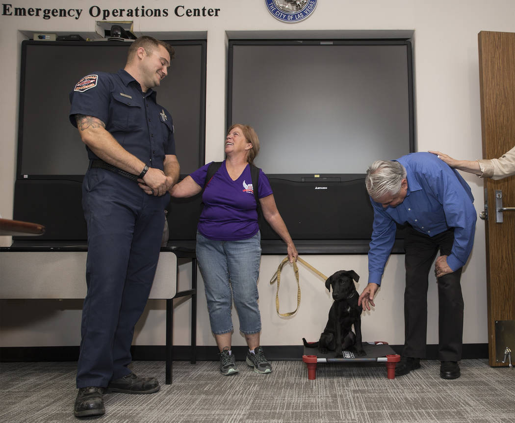 Las Vegas Fire and Rescue firefighter/paramedic Tony Brown, left, shares a laugh with Linda Sla ...