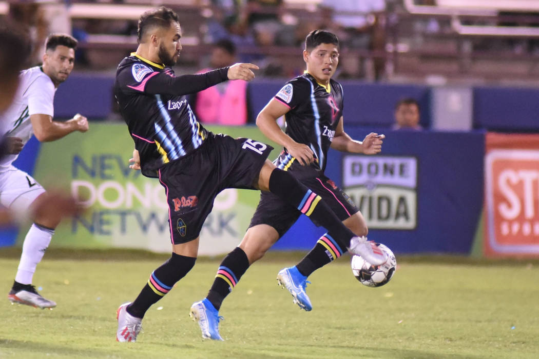 Lights defender Bryan De La Fuente, right, shown last month, fed a pass into the goal mouth tha ...