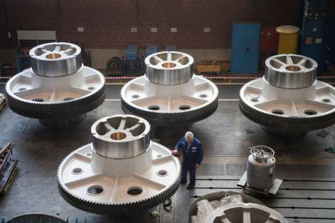 In a March 2, 2018, file photo, a worker cleans big machine parts of presses manufacturer Schü ...
