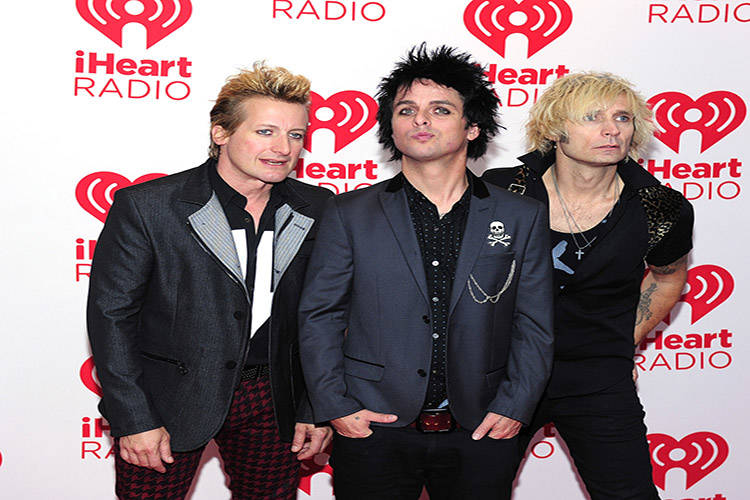Drummer Tre Cool, frontman Billie Joe Armstrong and bassist Mike Dirnt of the band Green Day po ...
