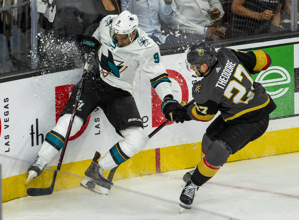 San Jose Sharks left wing Evander Kane (9) crashes the boards with Golden Knights defenseman Sh ...