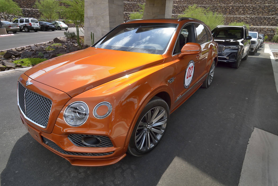 Bill Hughes Real Estate Millions A 2019 Bentley Bentayga Speed is in a line of luxury vehicles ...