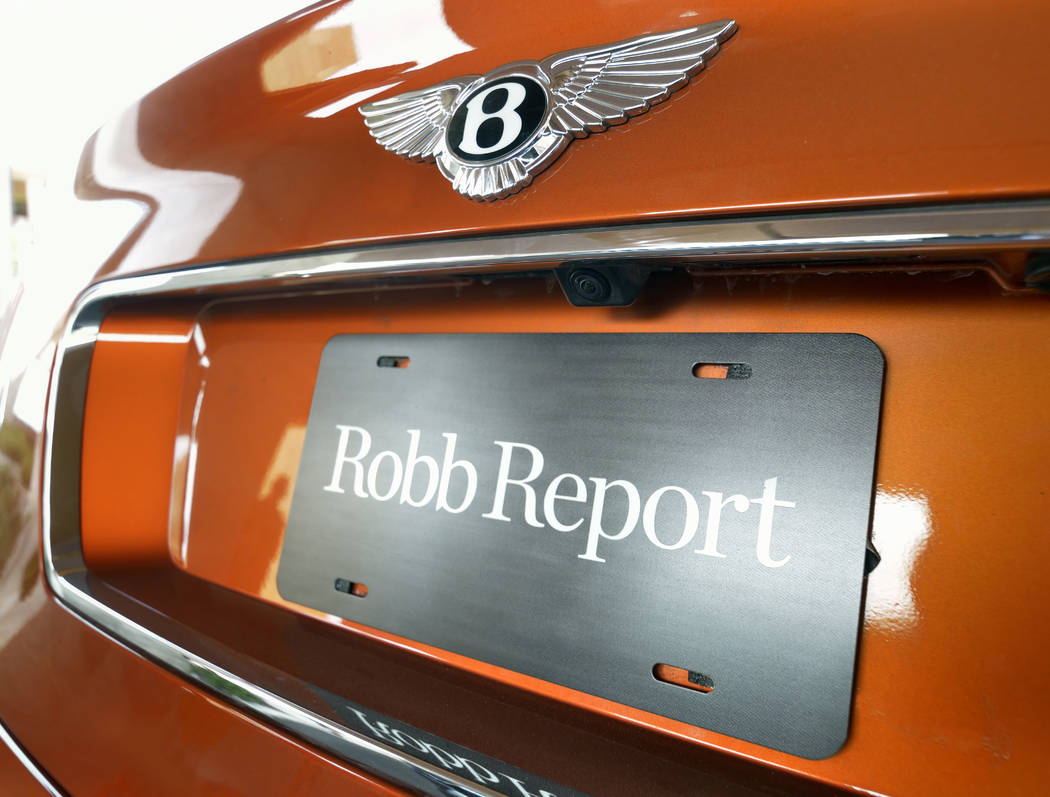 Bill Hughes Real Estate Millions The back of a 2019 Bentley Bentayga Speed shows a Robb Report ...