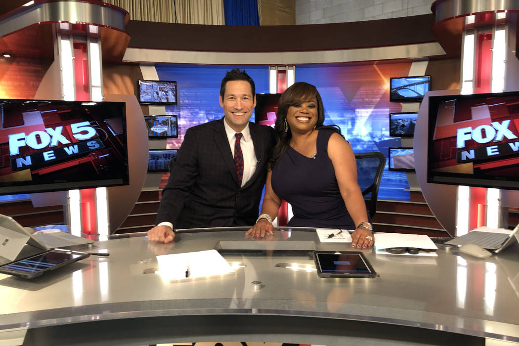 Jason Feinberg and Monica Jackson are shown on the Fox 5 news set on Jackson's final day with t ...
