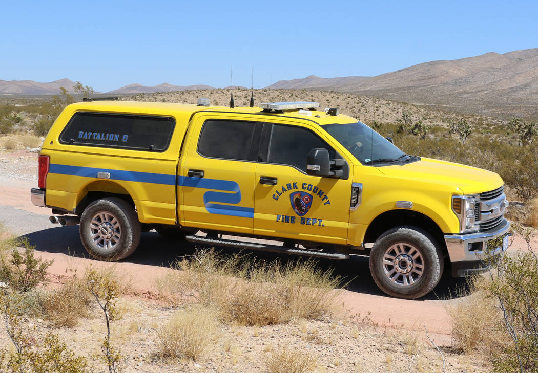 An emergency vehicle is seen near Goodsprings, southwest of Las Vegas, where a hot air balloon ...