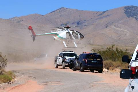 A Metro police helicopter lands near Goodsprings, southwest of Las Vegas, where a hot air ballo ...