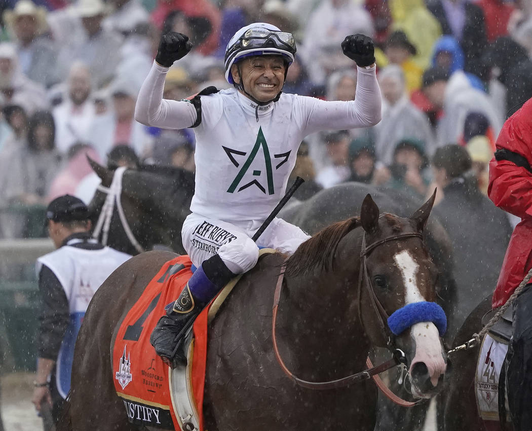 Mike Smith celebrates after riding Justify to victory during the 144th running of the Kentucky ...