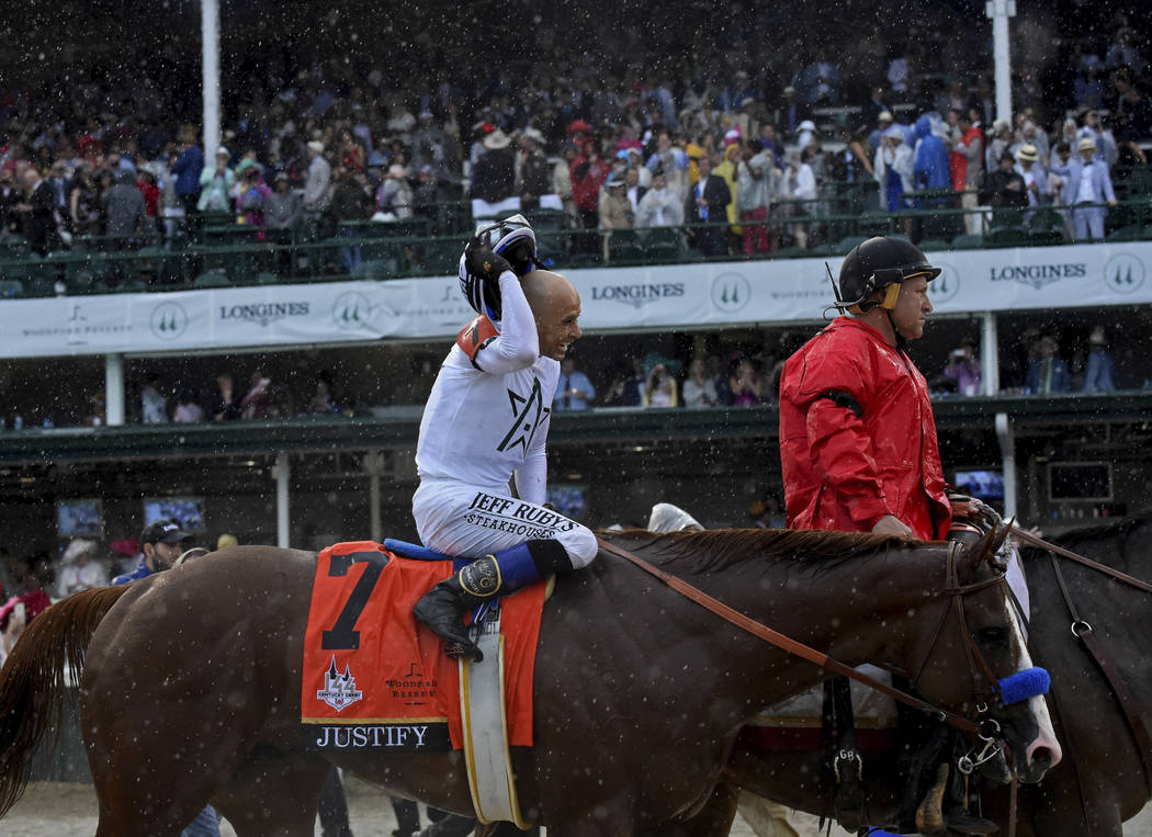 Jockey Mike Smith smiles after riding Justify to win the 144th running of the Kentucky Derby, t ...