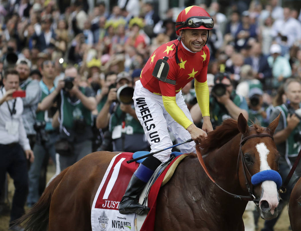 FILE - In this June 9, 2018, file photo, jockey Mike Smith celebrates riding Justify to win the ...