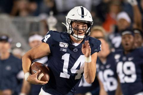 Penn State quarterback Sean Clifford (14) runs during an NCAA college football game in State Co ...