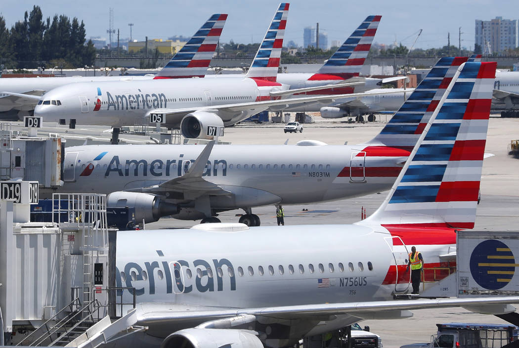 In an April 24, 2019, photo, American Airlines aircraft are shown parked at their gates at Miam ...