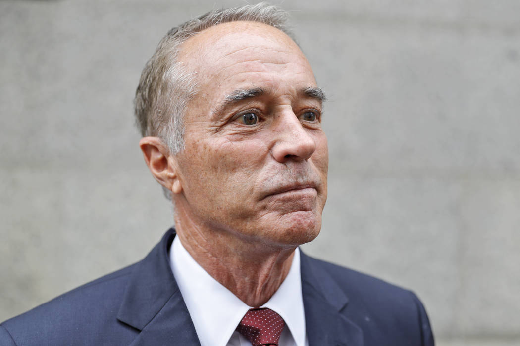U.S. Rep. Chris Collins, R-N.Y., speaks to reporters as he leaves the courthouse after a pretri ...