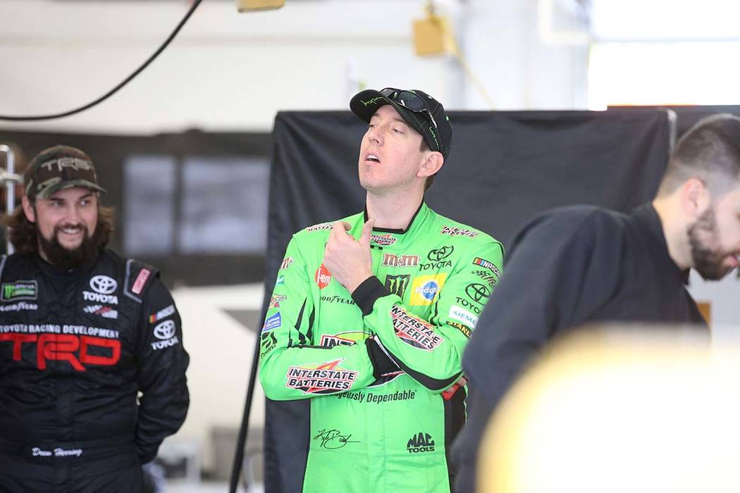 NASCAR driver and Las Vegas native Kyle Busch, center, in his garage during testing at Las Vega ...