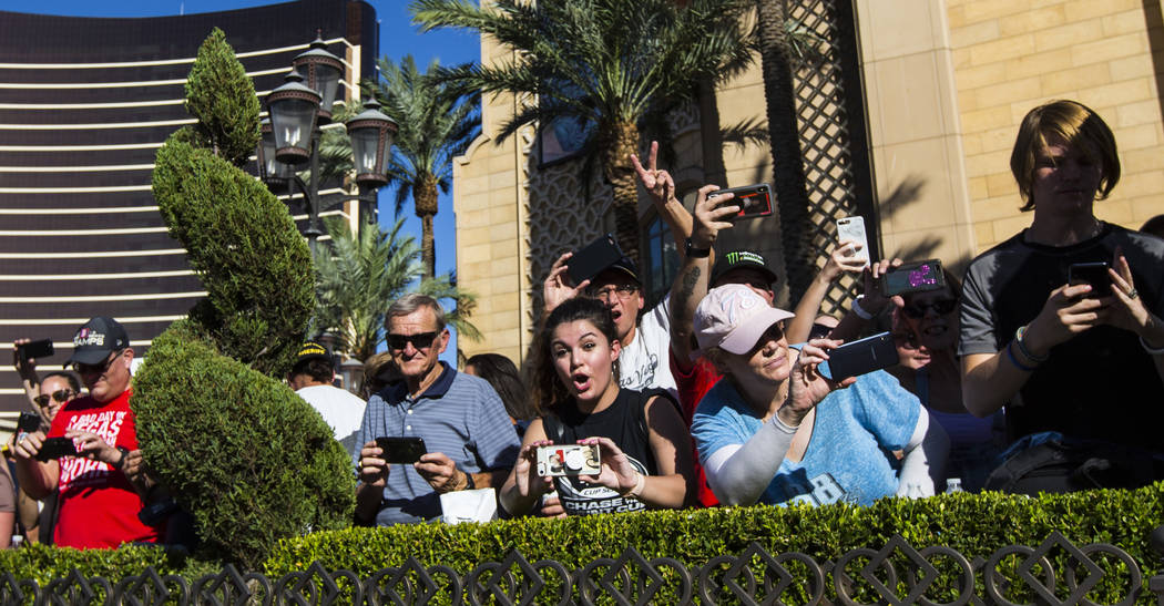 Fans clamor to take pictures of Kyle Busch outside of The Palazzo during the NASCAR America Bur ...