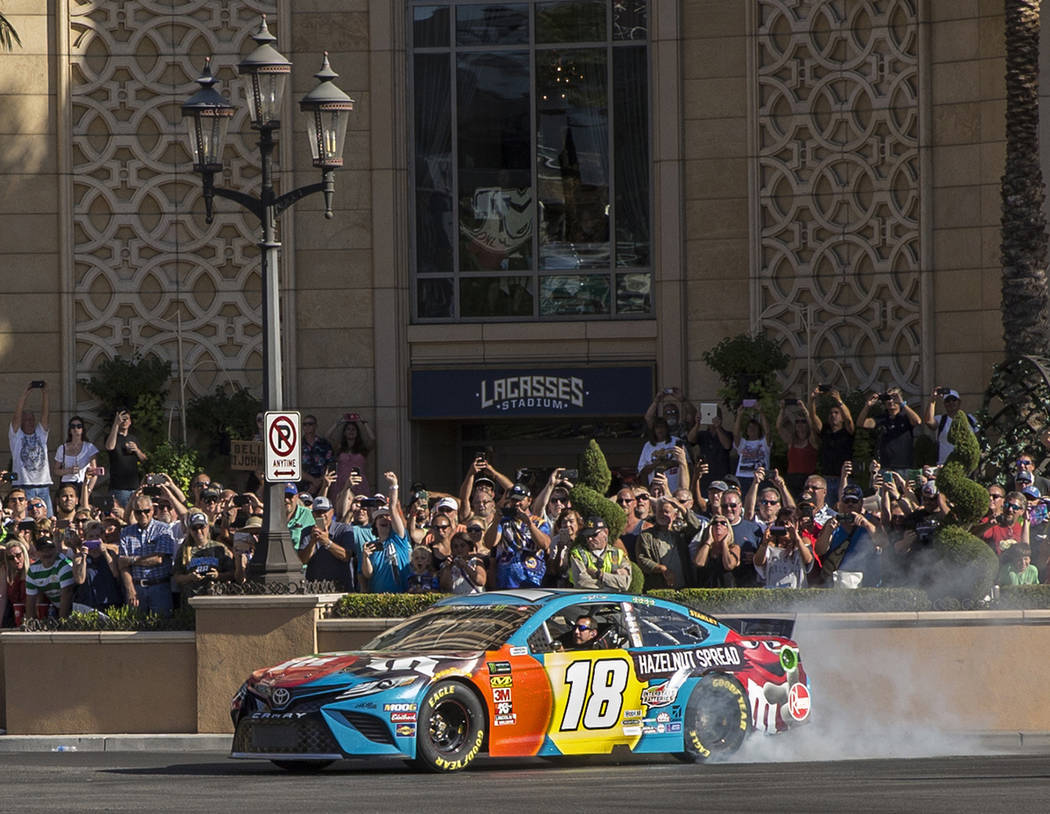 Kyle Busch does a burnout at the intersection of East Sands Avenue and South Las Vegas Boulevar ...