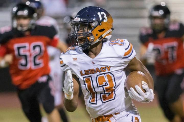 Legacy sophomore wide receiver Aaron Holloway (13) breaks into the open field past Las Vegas de ...