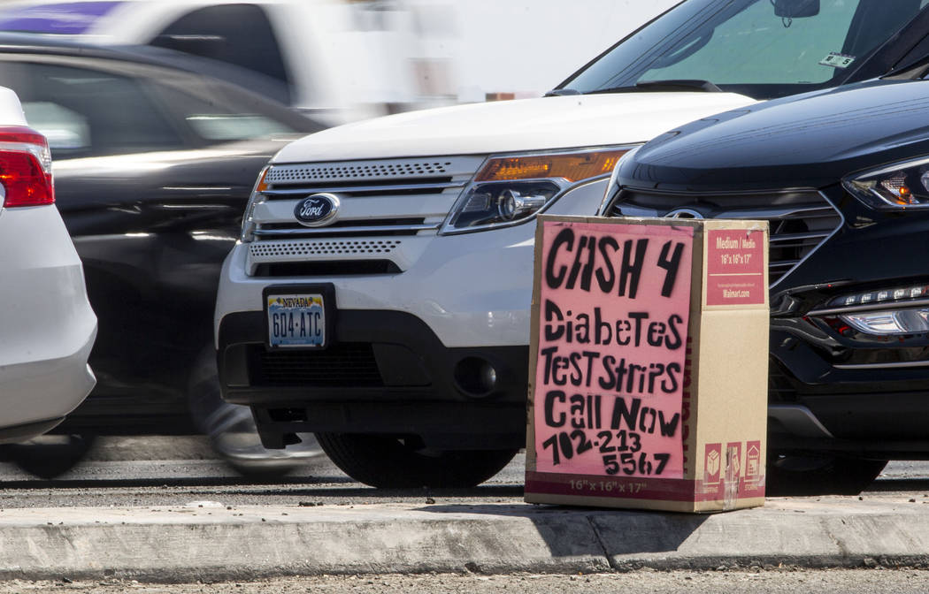 A box offering cash for diabetes testing strips is seen on West Cheyenne Avenue and North Marti ...