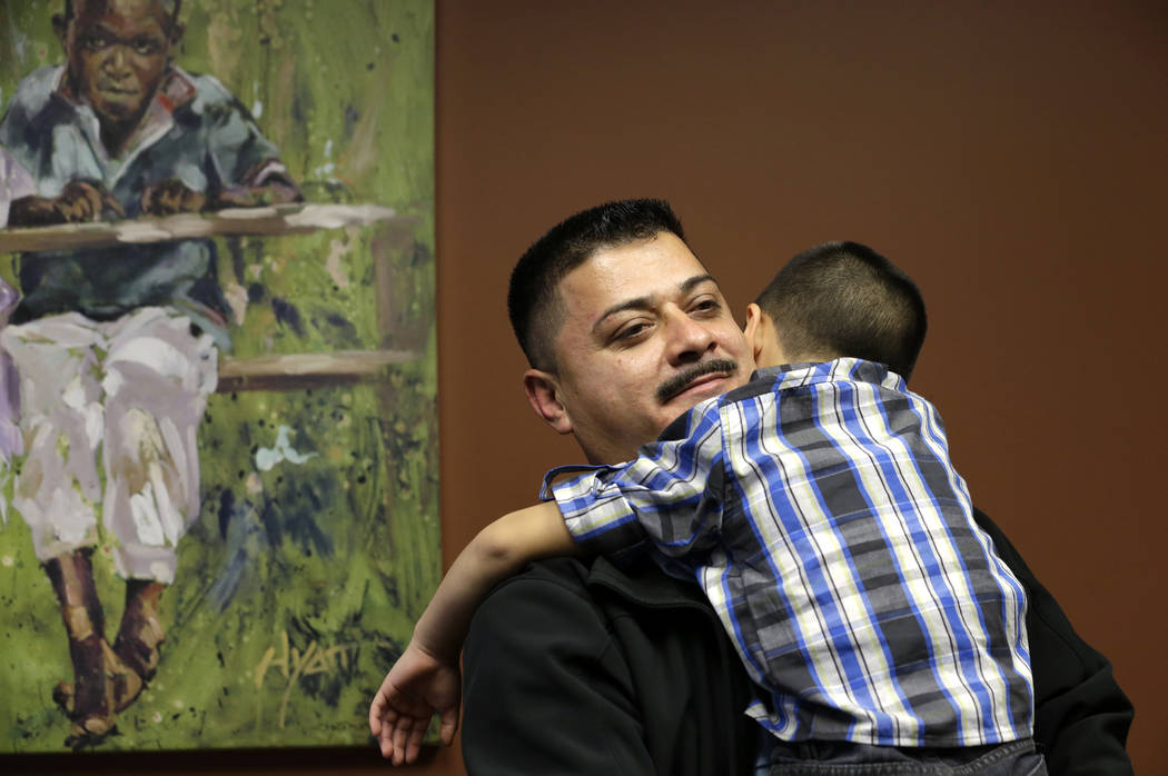 FILE - In this Friday, Oct. 17, 2014 file photo, Ignacio Lanuza-Torres holds his son, Isaiah, 4 ...
