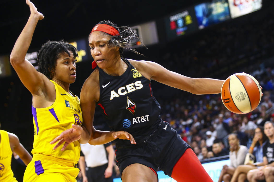 Las Vegas Aces' A'ja Wilson, right, drives to the basket against Los Angeles Sparks' Tierra Ruf ...