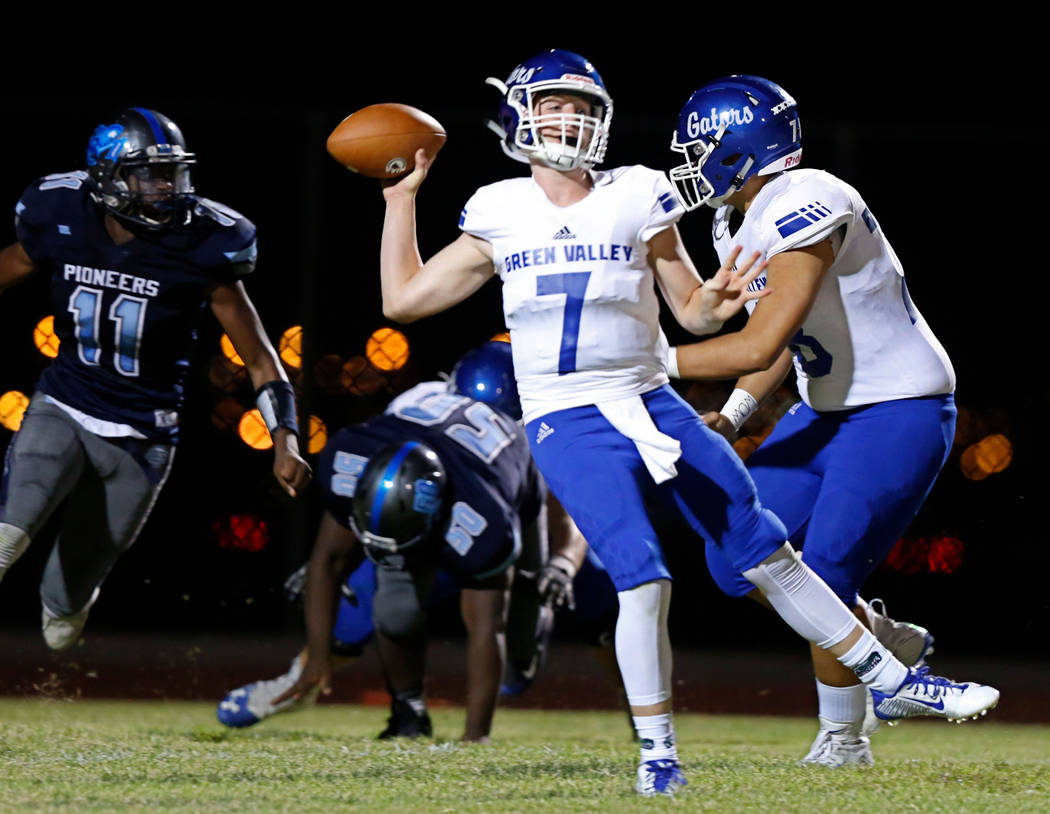 Green Valley's Garrett Castro (7) passes against Canyon Springs in the first quarter of a footb ...