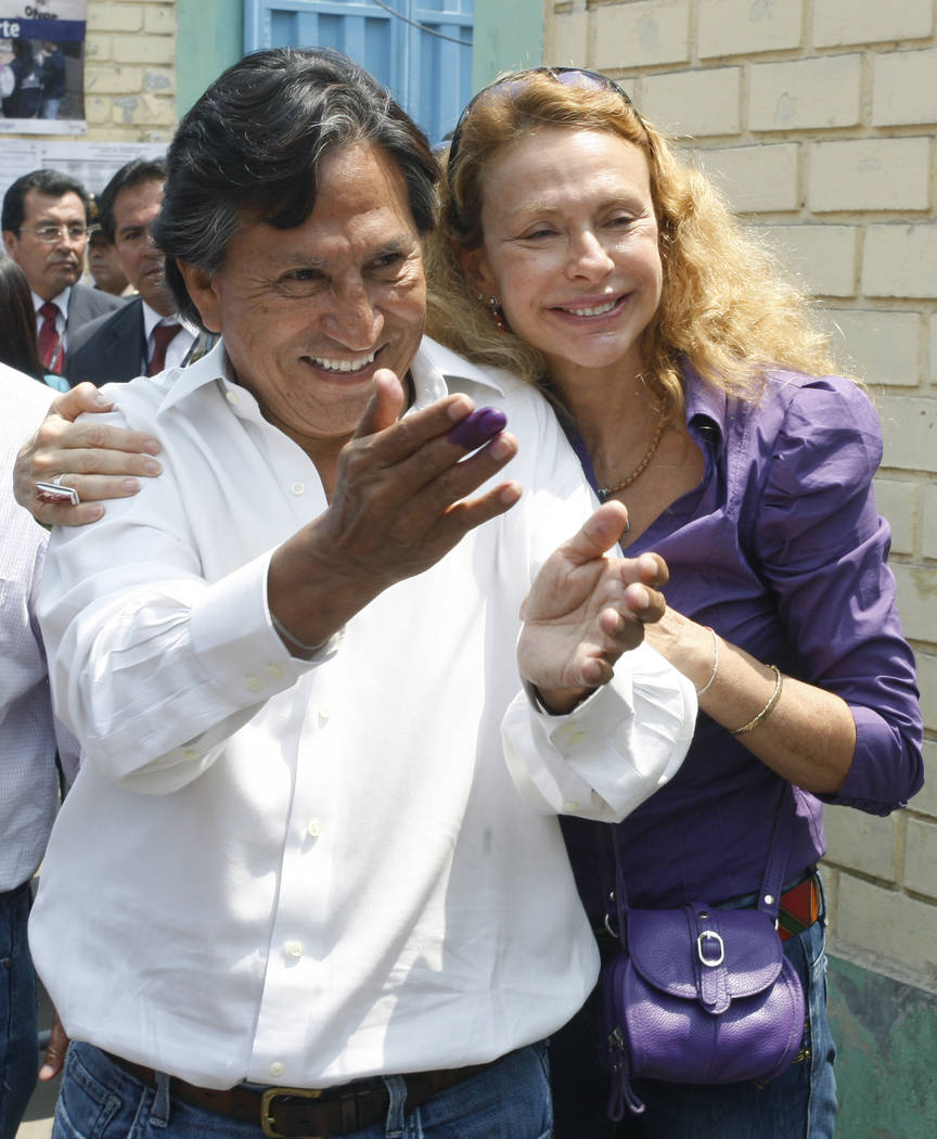 FILE - In this April 10, 2011 file photo Presidential candidate Alejandro Toledo, accompanied b ...