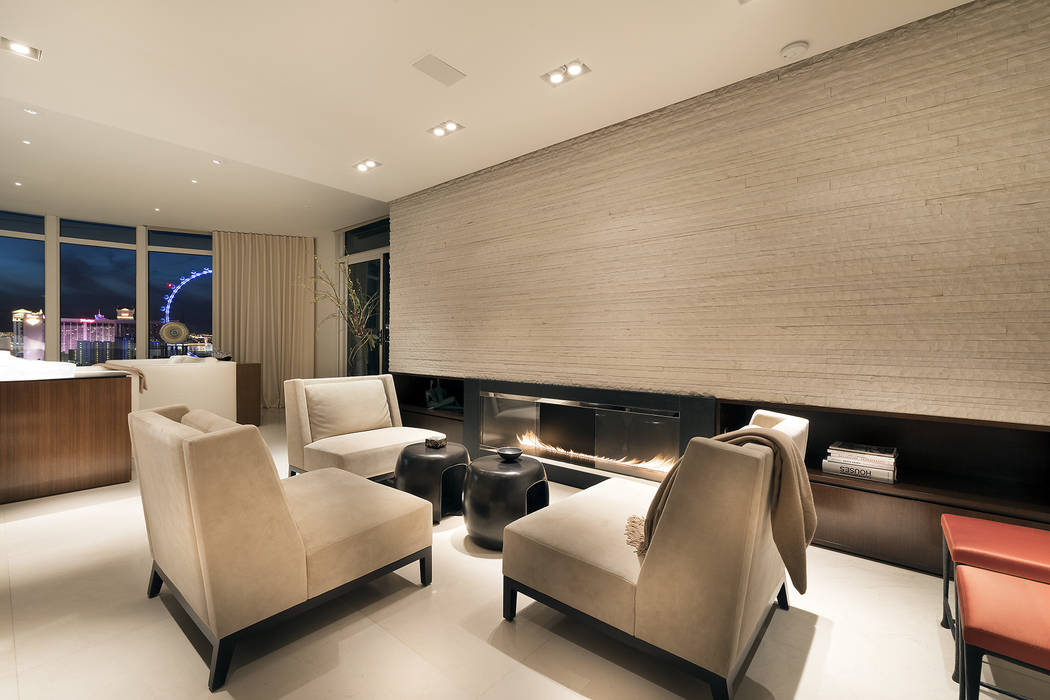The home's living room has a modern fireplace. (Ivan Sher Group)