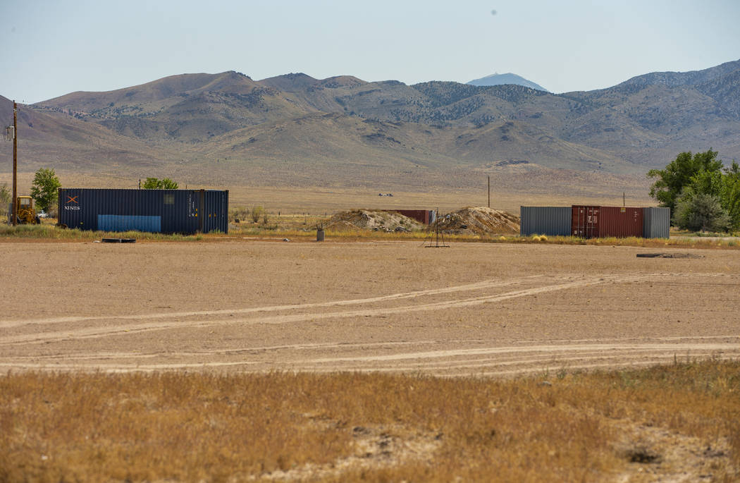 Alienstock supplies are told to be stored in two blue containers on property about the Little A ...
