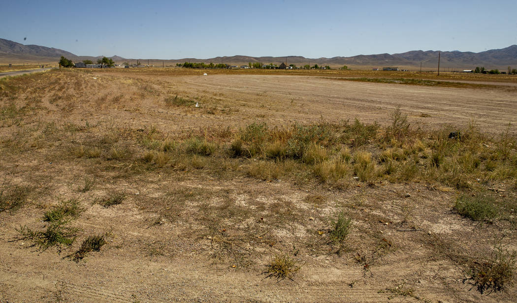 A piece of land yet prepared just south of the Little A'Le'Inn is slated to house parking and c ...