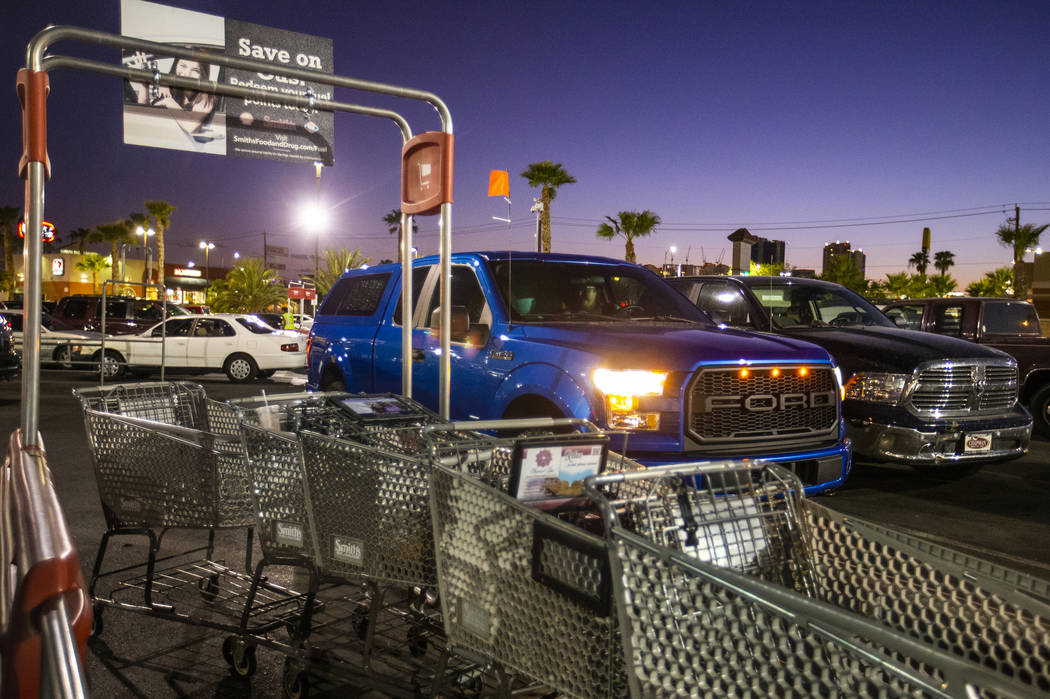 A blue truck in a supermarket parking lot transports guests to the secret Oakey Family Supper C ...