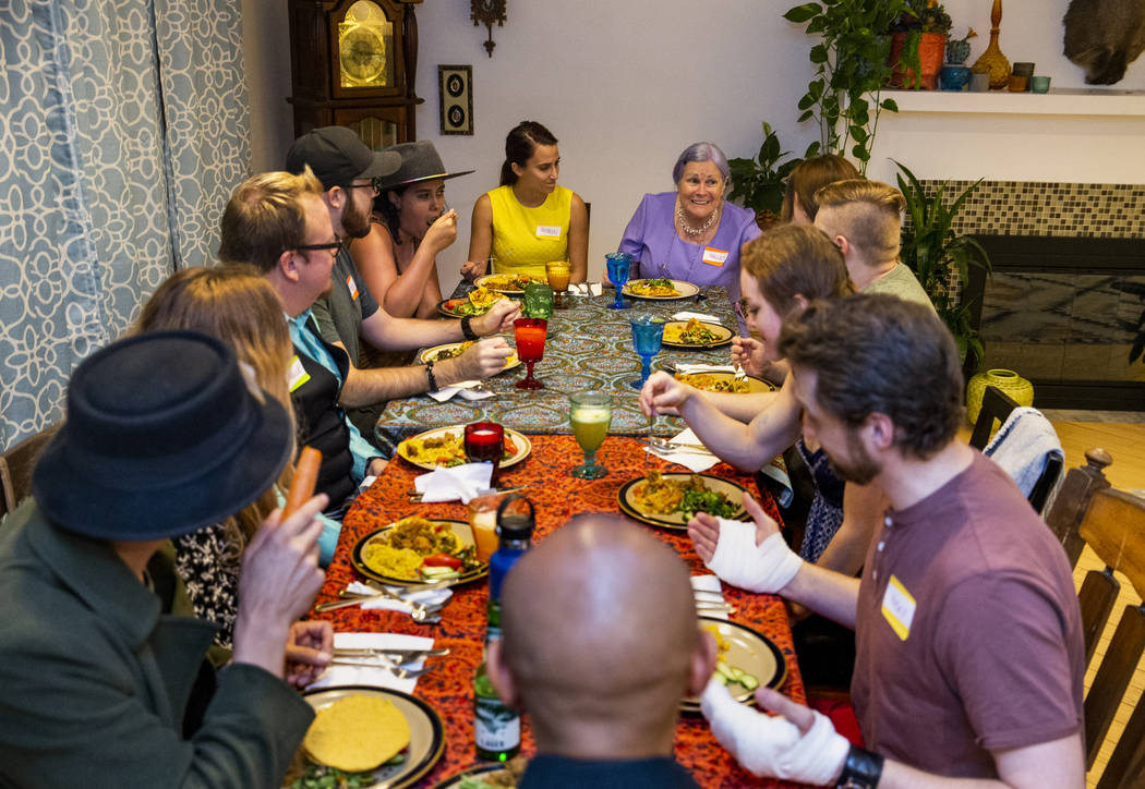 Guests enjoy a meal and conversation during the Oakey Family Supper Club event on Monday, Sept. ...